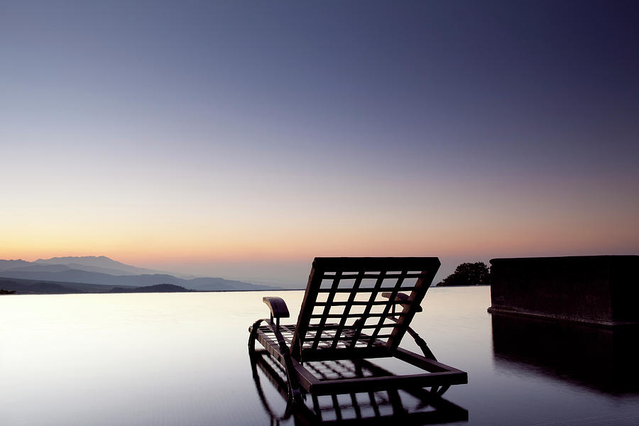 Empty Seat On An Infinity Pool Facing Photograph by Marcaux