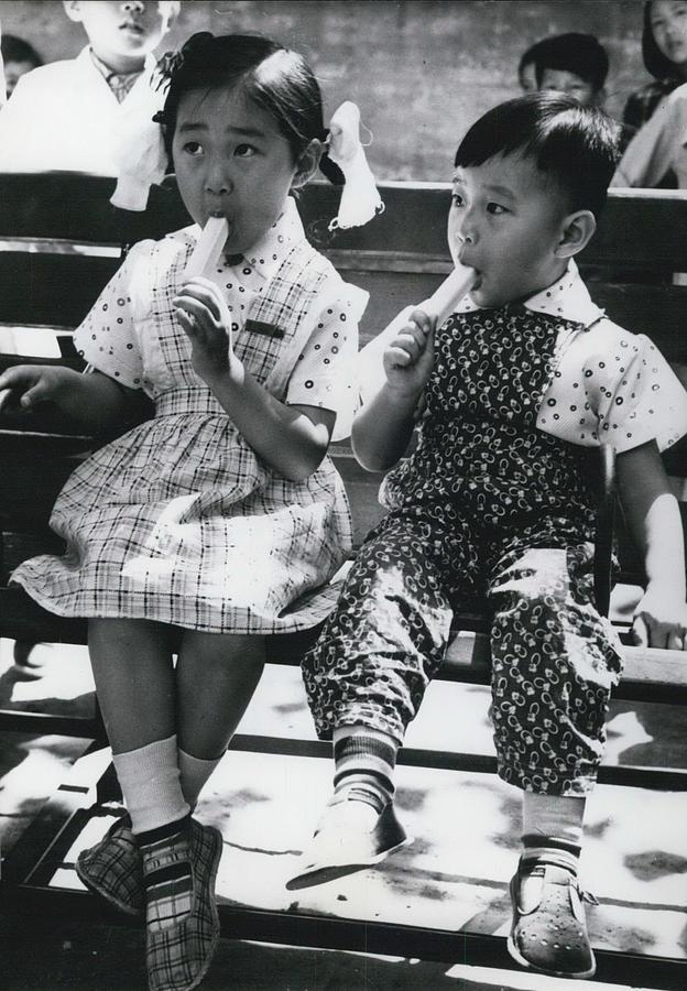 Retro Photograph - Enjoying Some Ice-cream by Retro Images Archive