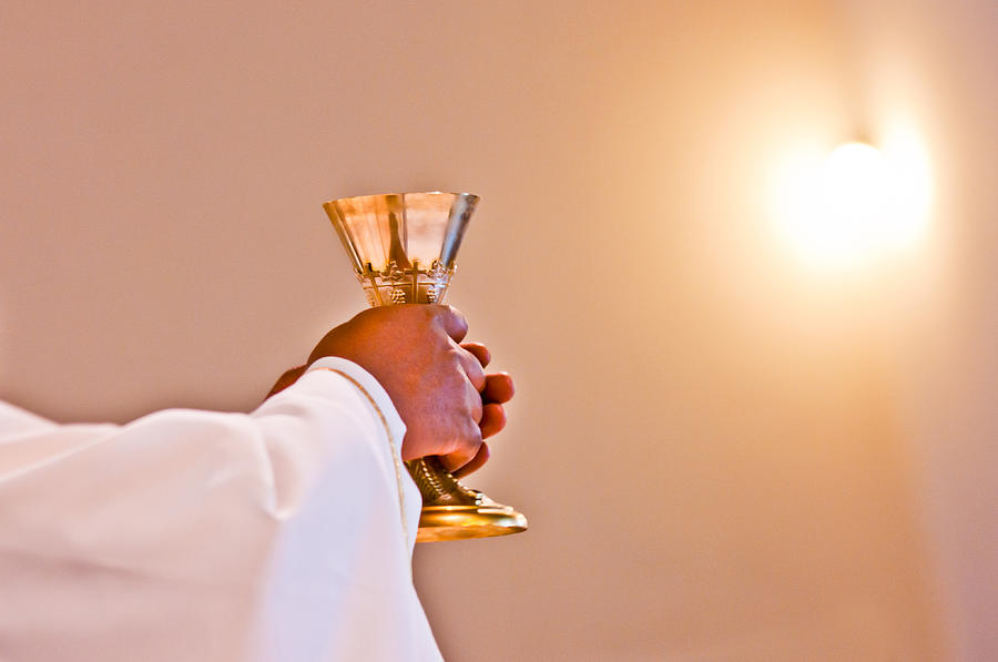 Eucharist of our Lord Jesus Christ Photograph by Piermichelemalucchi