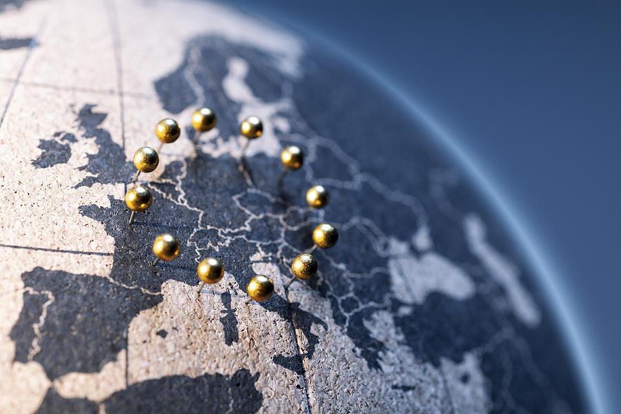 European Union - Golden pins on cork board globe Photograph by ThomasVogel