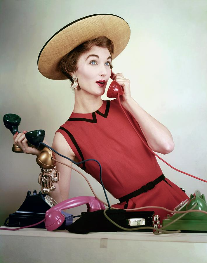 Evelyn Tripp Holding Telephones Photograph by Erwin Blumenfeld