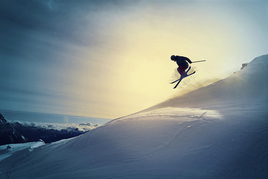 Extreme   Freestyle snow skier  jumping   Off pist  back country skiing Photograph by Ultramarinfoto