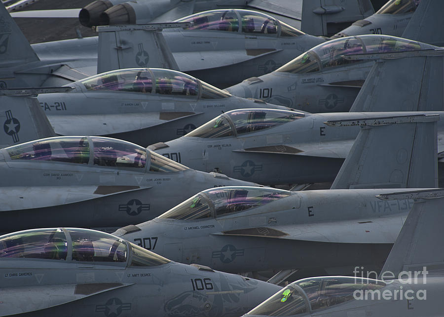 Sailors Photograph - Fa18 Super Hornets Sit On The Flight Deck Of The Aircraft Carrier Uss Enterprise  by Paul Fearn