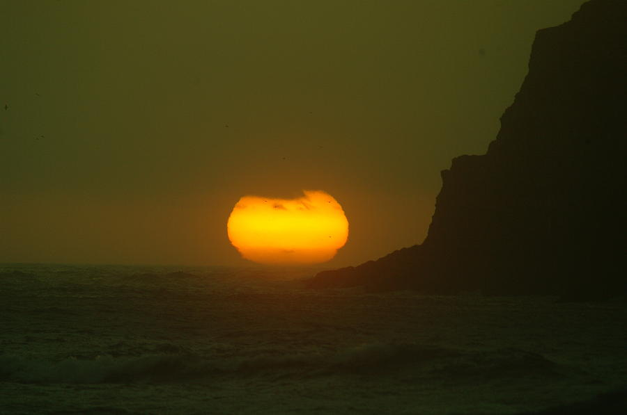 Sun Photograph - Falling Into The Waves by Jeff Swan