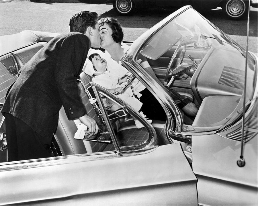 1956 Photograph - Family Kiss by Underwood Archives