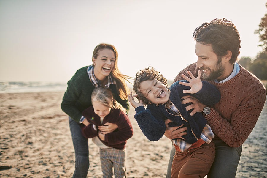 Family on the beach Photograph by Geber86