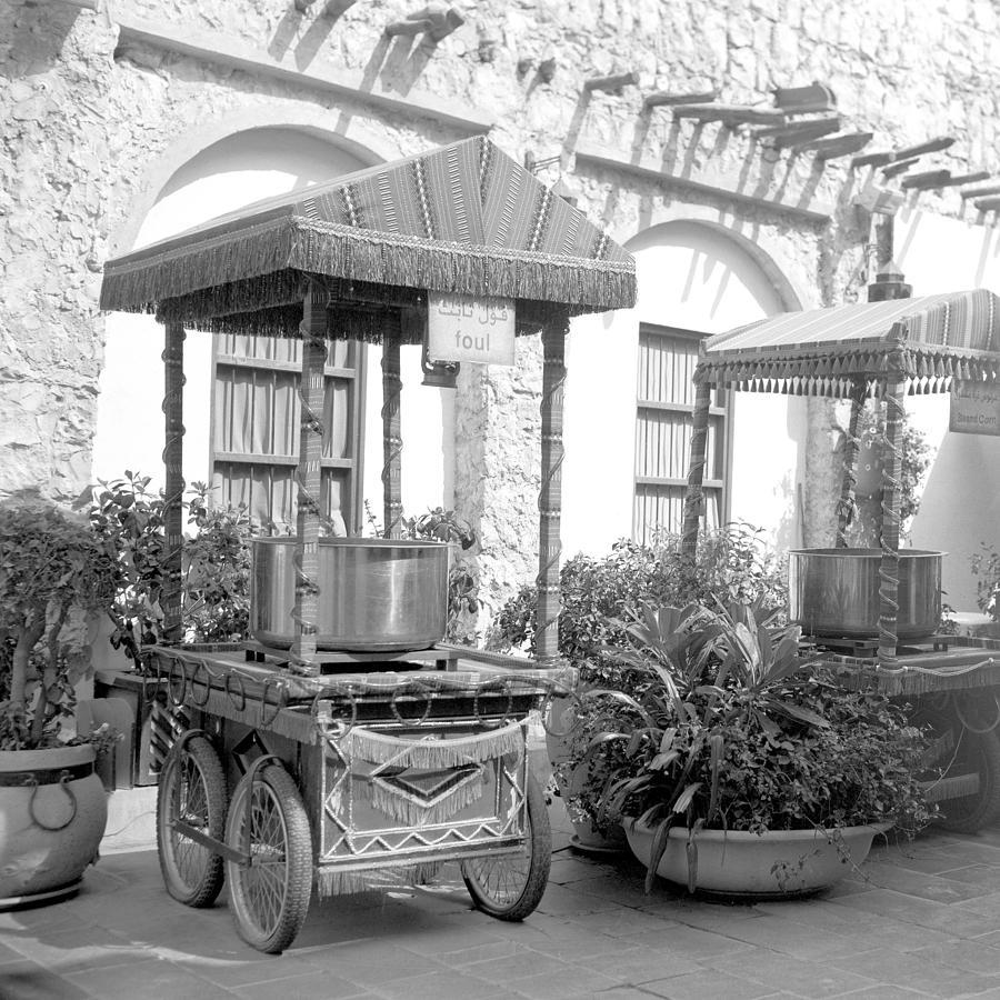 Doha Photograph - Fast Food Carts In An Arab Souq by Paul Cowan