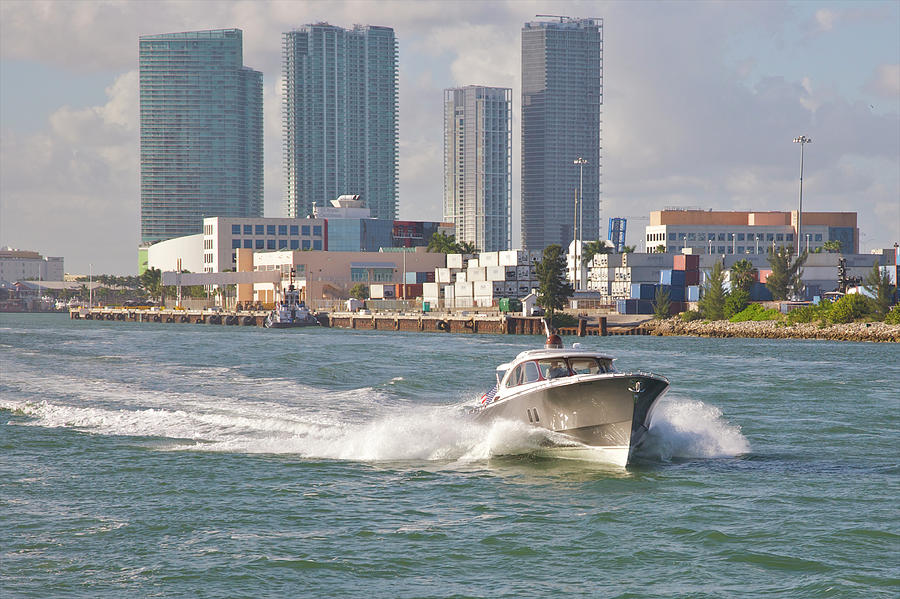 Fast-moving Pleasure Boat On City Waters Photograph by Barry Winiker