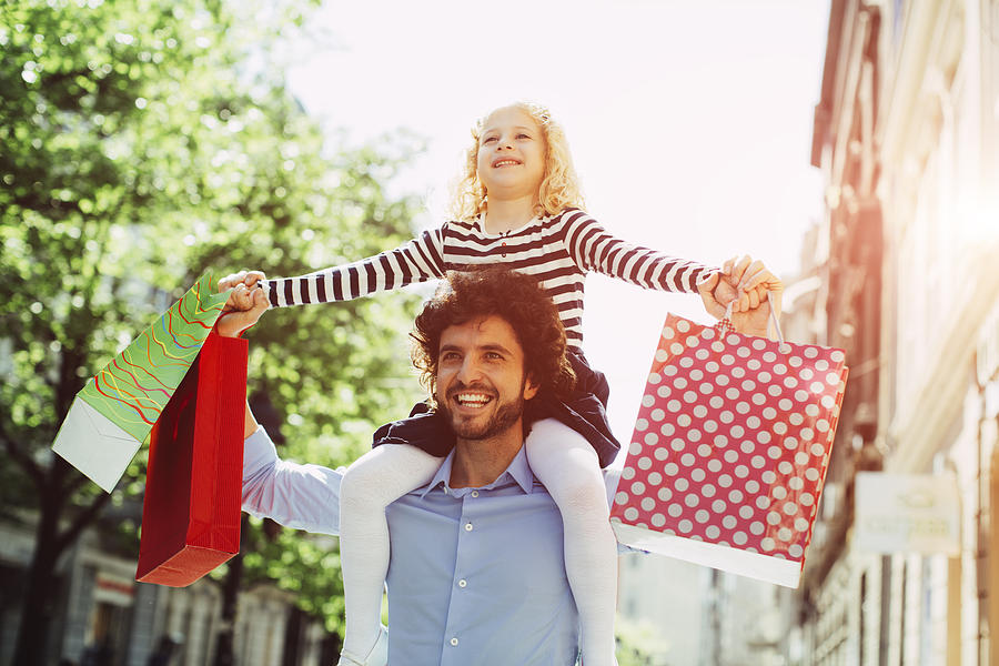 Father And Daughter Shopping Together. Photograph by Vgajic