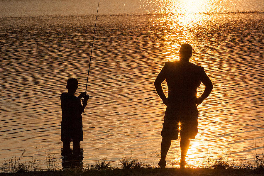 Father and son fishing at sunset photograph by aaron baker for Father son fishing