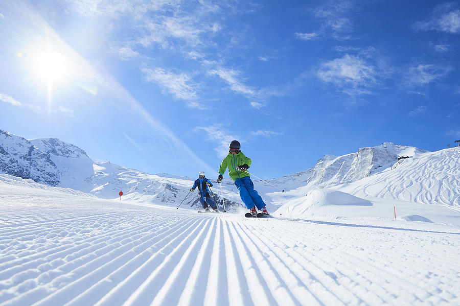 Father And Son On Skiing Holiday, Hintertux, Tirol, Austria Photograph by Jakob Helbig