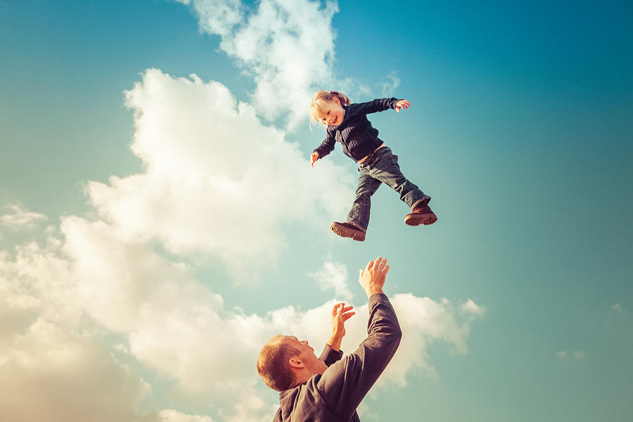 Father Catching Girl Falling From Cloudy Sky Photograph by Debibishop