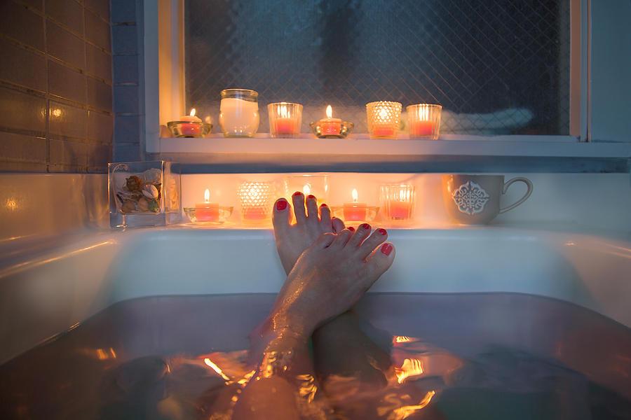 Feet in bath Photograph by YuriF