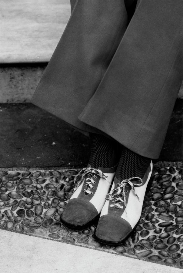 Feet Of A Model Wearing Two-tone Pant Shoes Photograph by William Connors