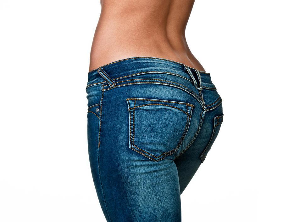 Female buttocks Photograph by John Sommer