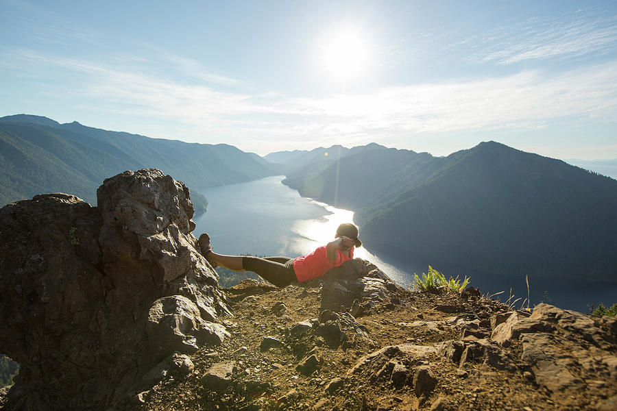Nature Photograph - Female Hiker Relaxing At Top Of Mount by Matt Andrew