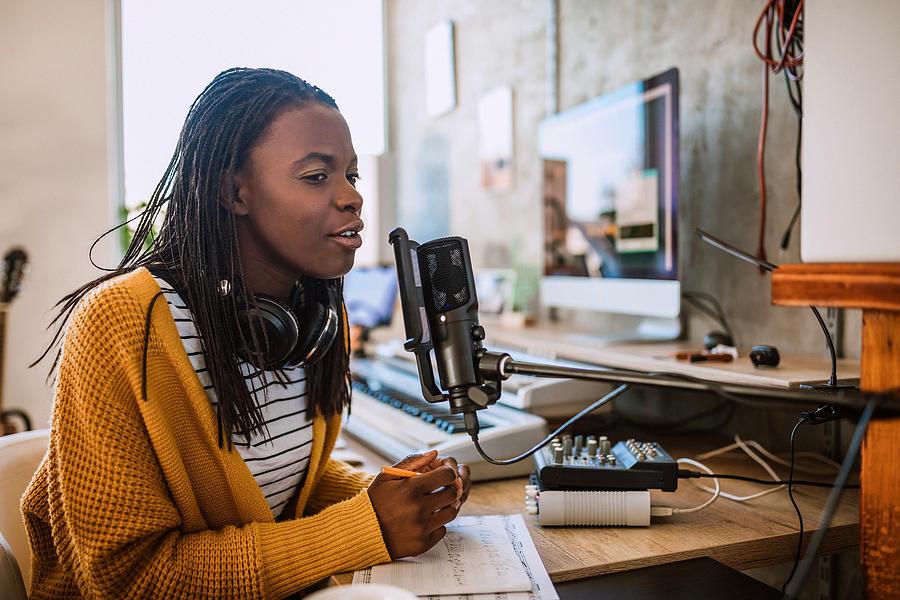 Female host on radio station Photograph by Pekic