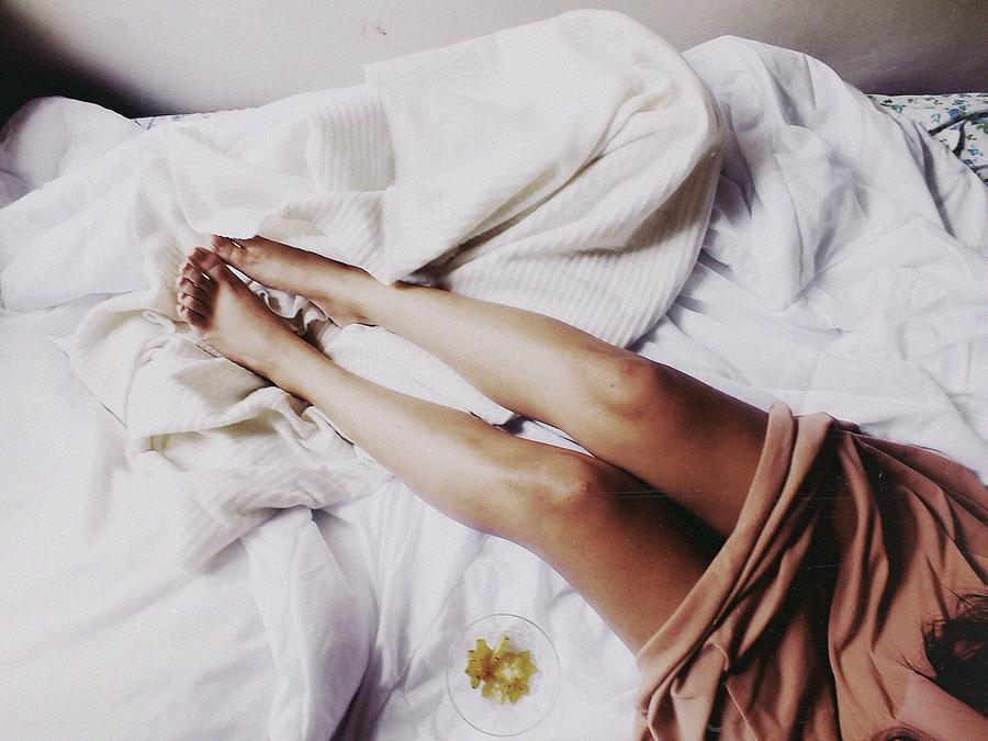 Female Legs On Bed Photograph by Andrea Guerra / EyeEm
