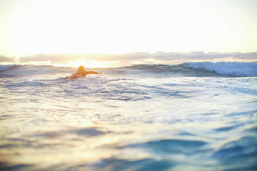 Female Surfer Swimming Out To Waves On Photograph by Moof