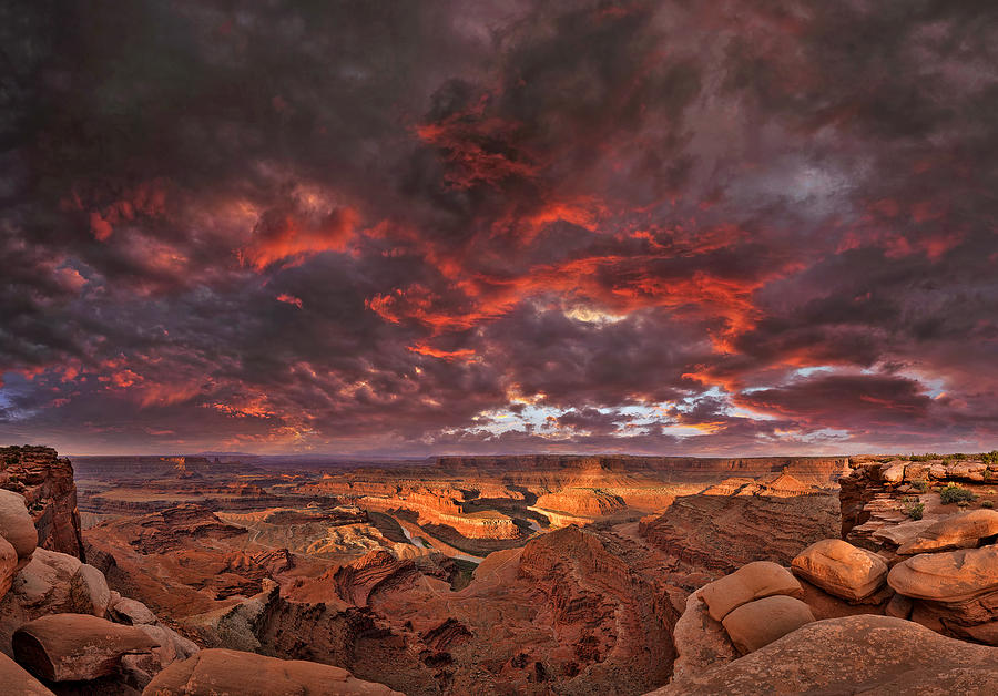 Ancient Photograph - Fiery sunrise over Dead Horse Point State Park by Sebastien Coursol