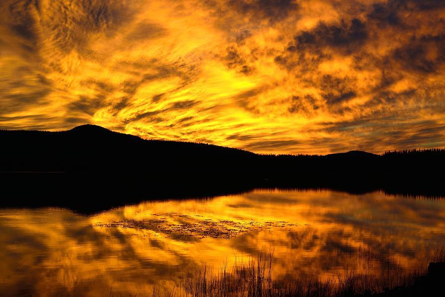 Sunrise Photograph - Fiery Sunrise Over Medicine Lake by Rich Rauenzahn
