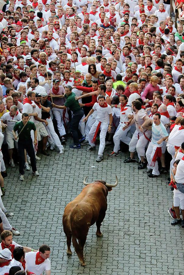 Fiesta De San Fermin Running Of The Photograph by Pablo Blazquez Dominguez