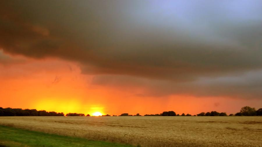 Sunset Photograph - Fighting Sun by Dave Woodbridge