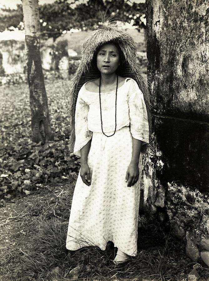 Portrait Photograph - Filipino Woman In Traditional Rain Cape by American Philosophical Society
