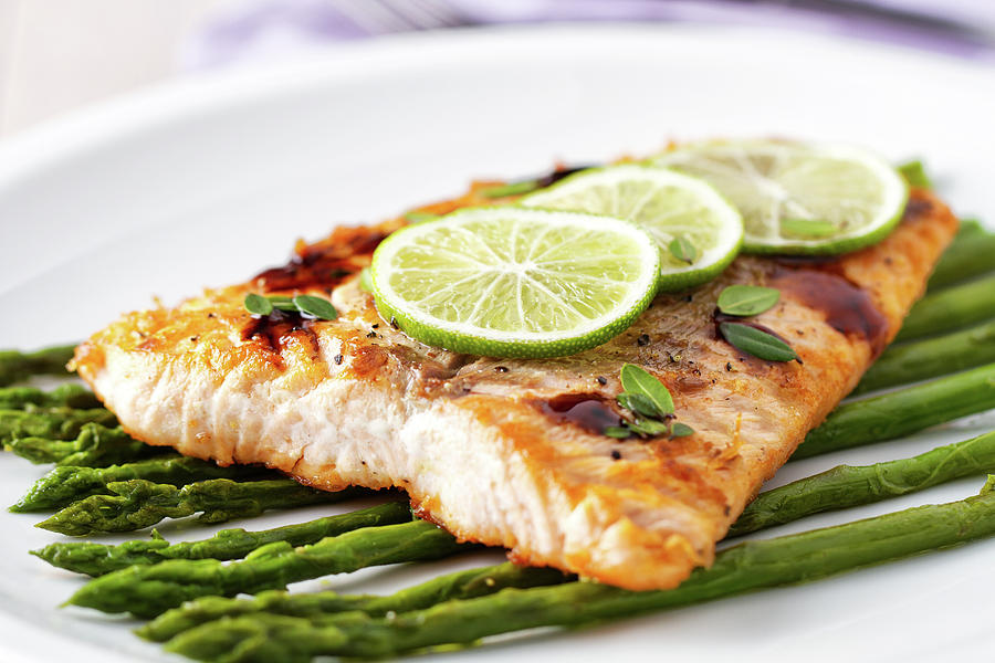 Fillet Of Salmon With Asparagus Photograph by Svariophoto