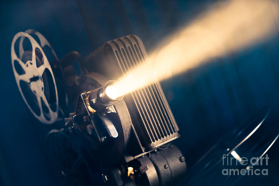 Flare Photograph - Film Projector On A Wooden Background by Fer Gregory
