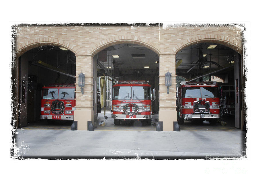 Fire Trucks At The Lafd Fire Station Are Decorated For Christmas Photograph - Fire Trucks At The Lafd Fire Station Are Decorated For Christmas by Nina Prommer