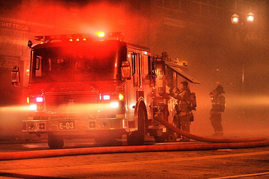Red Lights Firetruck Firemen Put On Air Tanks Smoke Street Lights Fire Hose Photograph - Firemen At Work by Donald Torgerson