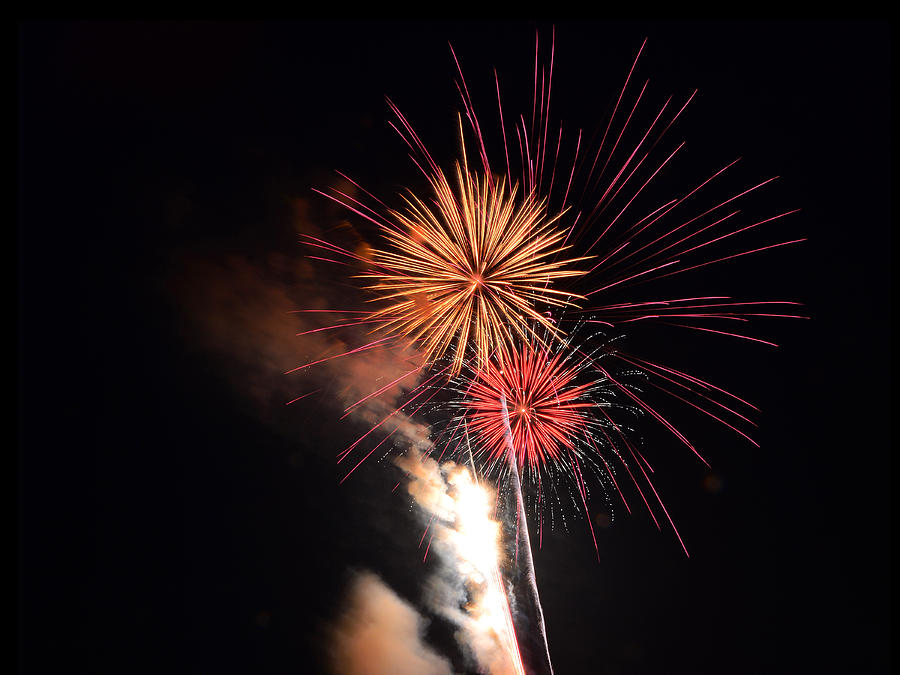 Fireworks of Gold and Purple with Smoke by Dylan Lees