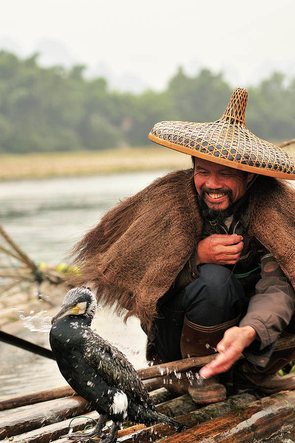 Fisherman And His Cormorant On Li River Photograph by Huang Xin