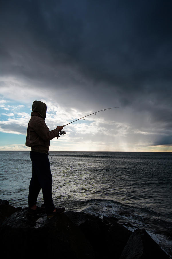 California Photograph - Fisherman Fishing While Storm Blows by Sam Wells