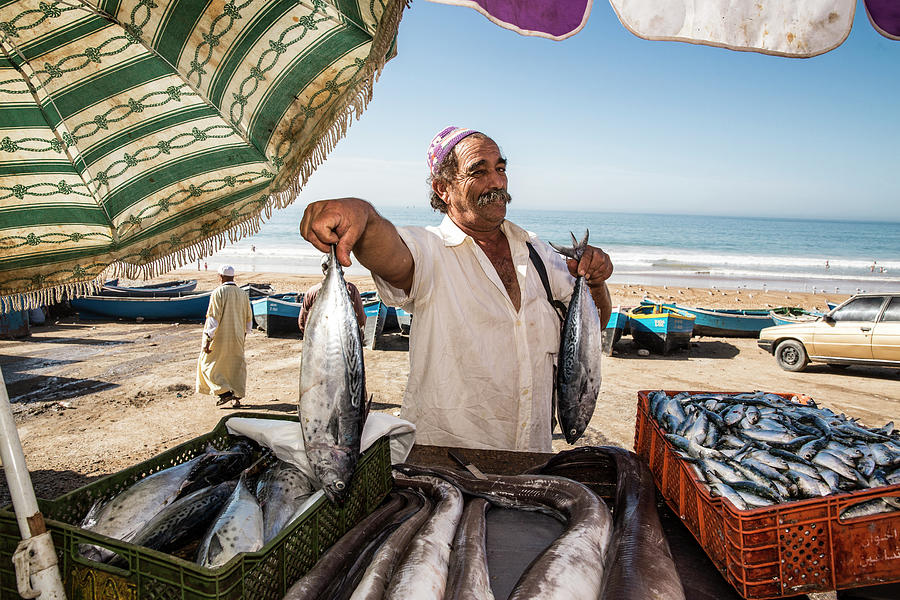 Fisherman Selling His Fish At Market On Photograph by Tim E White