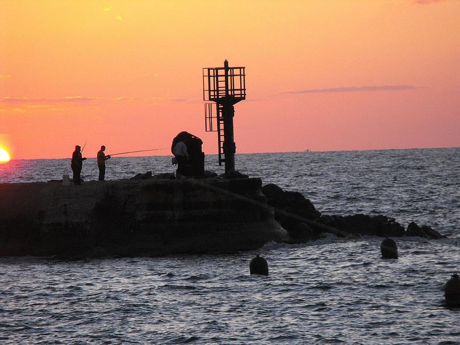Sunset Photograph - Fishermen At Sunset by Lionel Gaffen