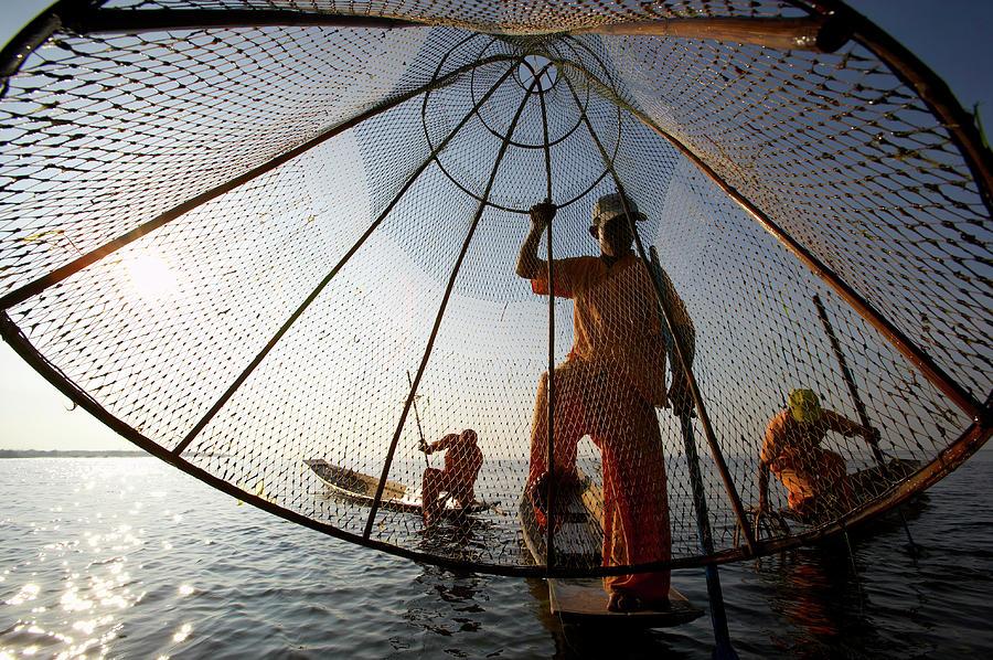 Fishermen In Traditional Orange Photograph by Johnny Haglund