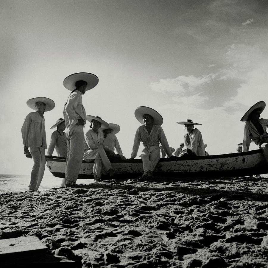 Fishermen On The Beach Of Pia De La Cuesta Photograph by Horst P. Horst