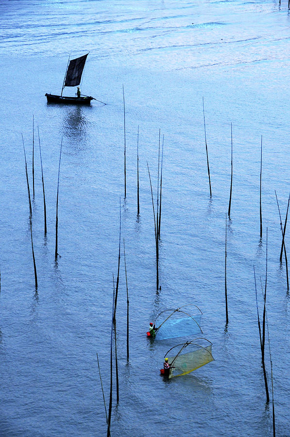 Fishermen Working In High-tide Mudflats Photograph by Melindachan