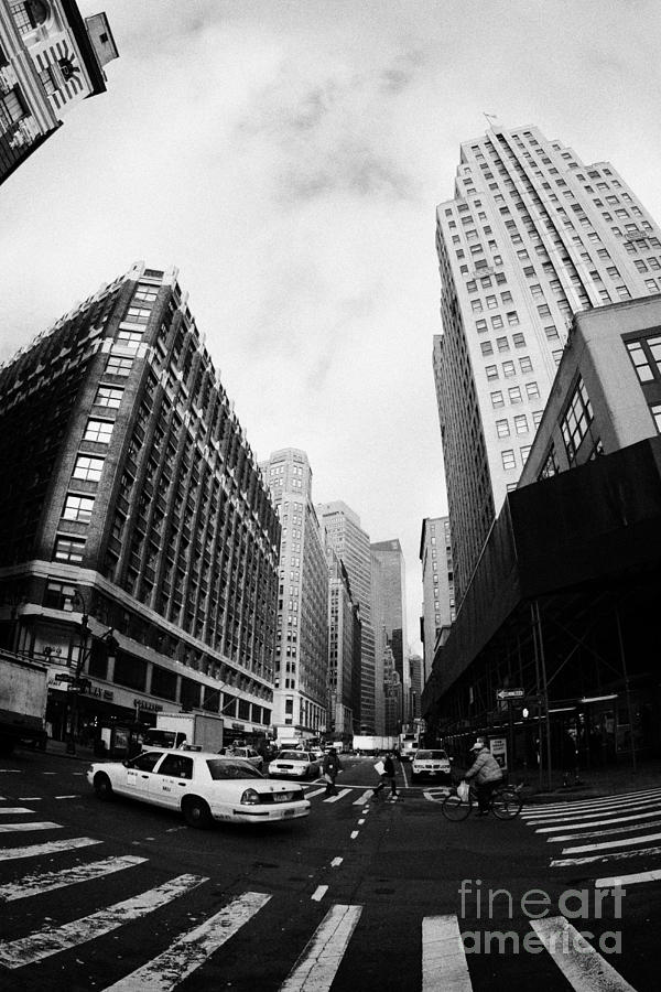 Usa Photograph - Fisheye Shot Of Yellow Cab On Intersection Of Broadway And 35th Street At Herald Square New York by Joe Fox
