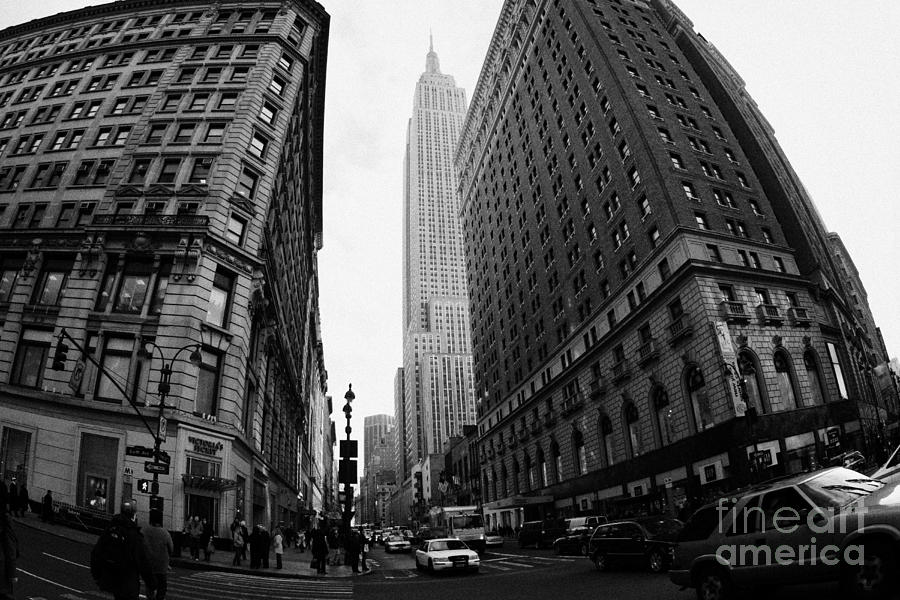 Usa Photograph - fisheye shot View of the empire state building from West 34th Street and Broadway junction by Joe Fox