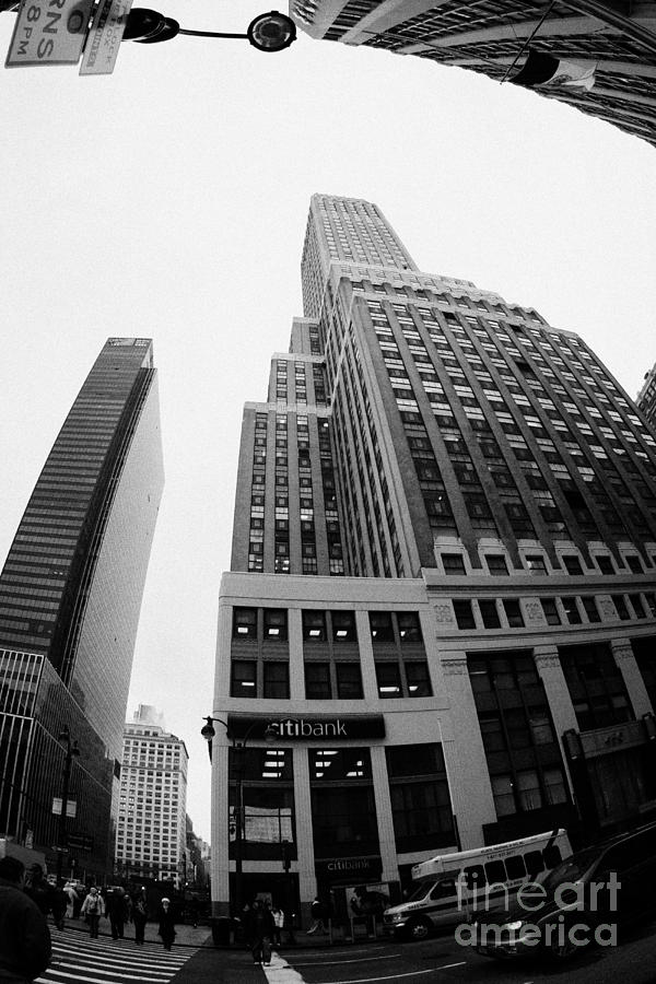 Usa Photograph - fisheye view of the Nelson Tower and 1 penn plaza in the background from junction of 34th street and by Joe Fox