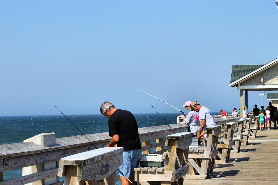 Pier Photograph - Fishing Is Serious Business by Carolyn Ricks