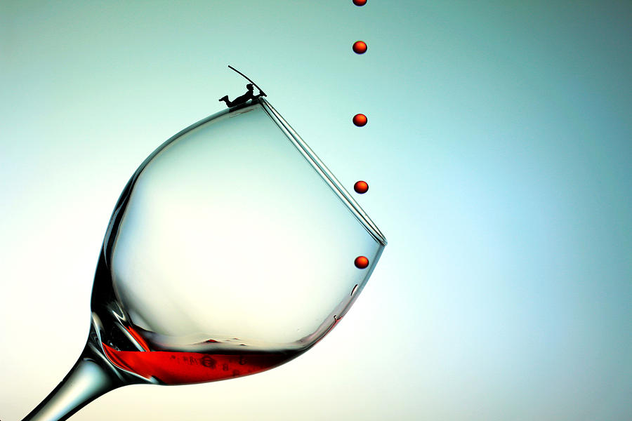 Red Photograph - Fishing On A Glass Cup With Red Wine Droplets Little People On Food by Paul Ge