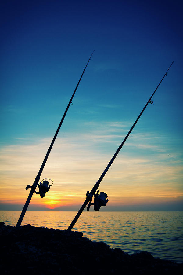 Fishing Rods In The Sunset Photograph by Gaspr13