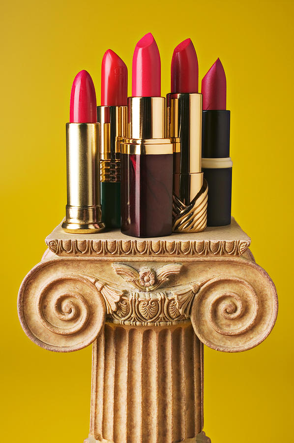 Cosmetics Photograph - Five Red Lipstick Tubes On Pedestal by Garry Gay