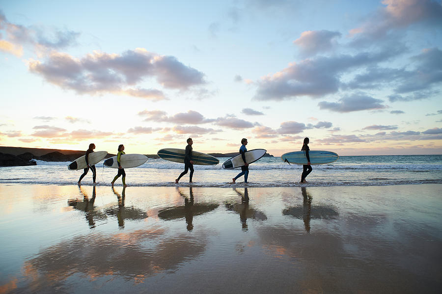 Five Surfers Walk Along Beach With Surf Photograph by Dougal Waters