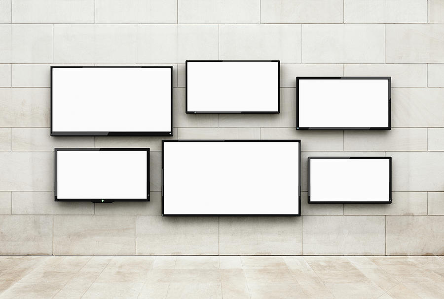 Flat Screens Hanging On A Wall Photograph by Jorg Greuel