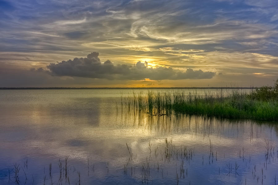 Clouds Photograph - Floating Over The Lake by Debra and Dave Vanderlaan